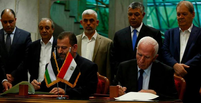 خلال توقيع  نائب رئيس المكتب السياسي صالح العاروري والأحمد اتفاق المصالحة