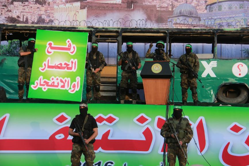 "Al-Qassam masked member raised the slogan ""Either siege lifting or explosion""."